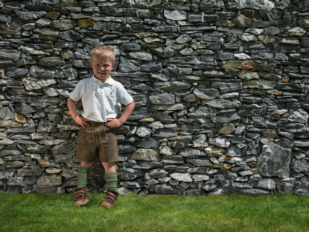 Boy at a stone wall