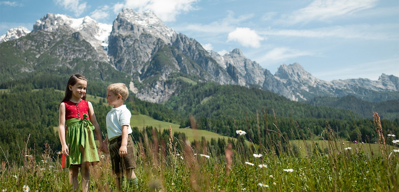 Children in a mountain meadow.