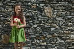 Girl at a stone wall